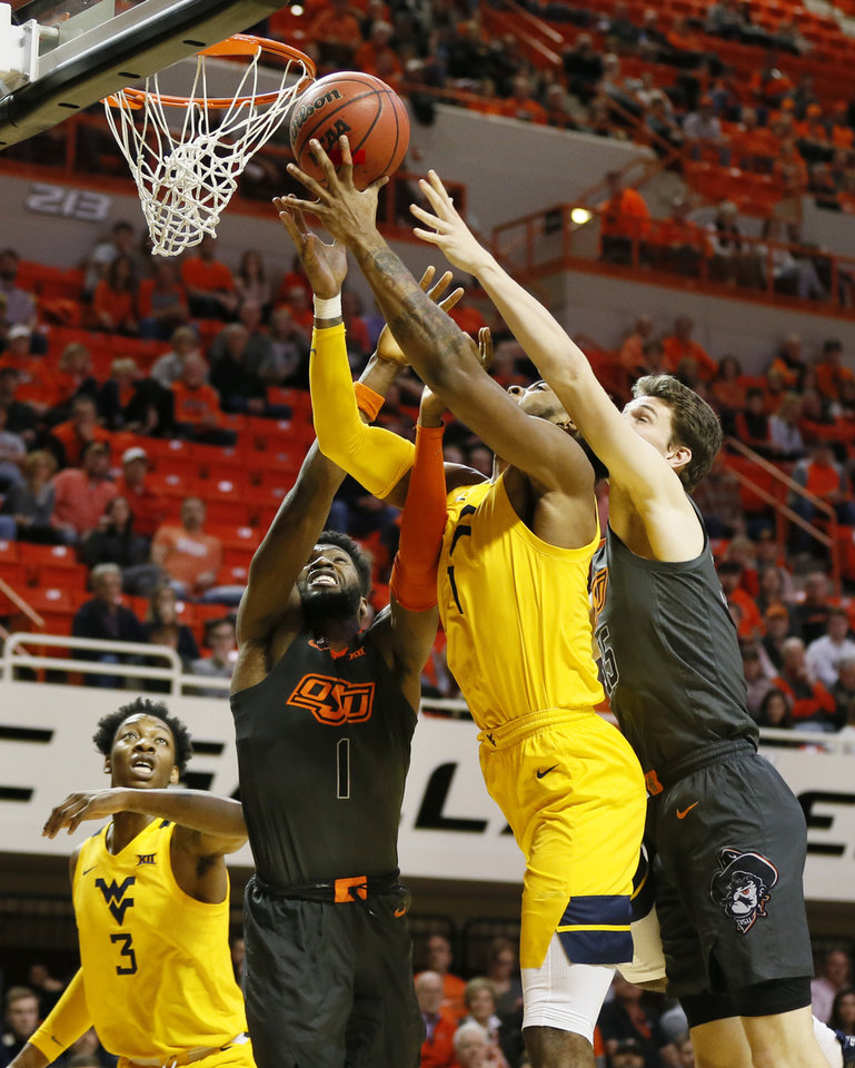 Photo - Oklahoma State's Jonathan Laurent (1), West Virginia's Derek Culver (1) and Oklahoma State's Hidde Roessink (35) try to rebound the ball as West Virginia's Gabe Osabuohien (3), left, looks on in the first half during a men's college basketball game between the Oklahoma State Cowboys and West Virginia Mountaineers at Gallagher-Iba Arena in Stillwater, Okla., Monday, Jan. 6, 2020. [Nate Billings/The Oklahoman]