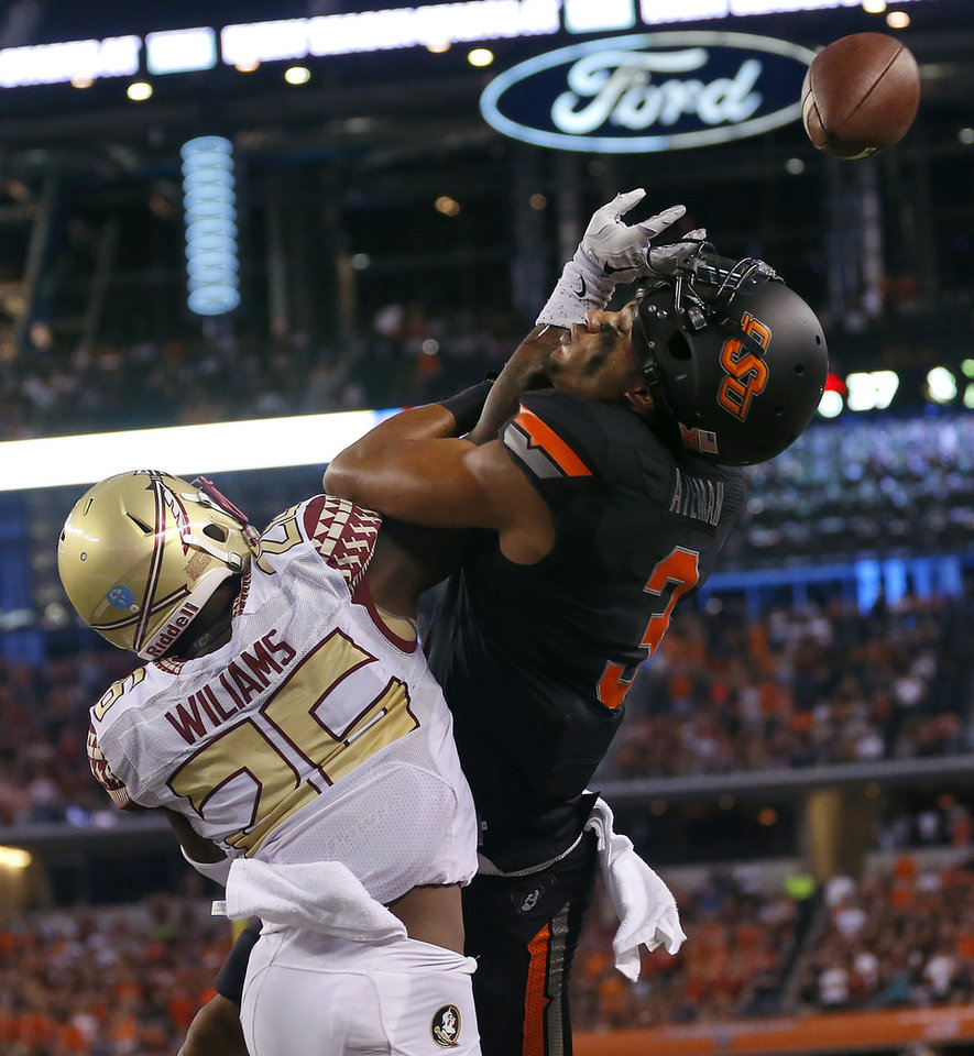 Photo - Florida State's P.J. Williams (26) breaks up a pass for Oklahoma State's Marcell Ateman (3) during the college football game between Oklahoma State University (OSU) and Florida State University (FSU) at the AdvoCare Cowboys Classic at AT&T Stadium in Arlington, Texas on Saturday, Aug. 30, 2014. Photo by Chris Landsberger, The Oklahoman