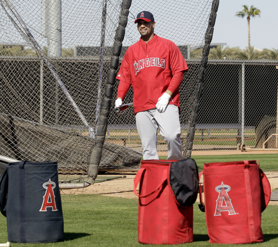 Los Angeles Angels\' Albert Pujols walks out of the batting cage during a baseball spring training workout Monday, Feb. 20, 2012, in Tempe, Ariz. (AP Photo/Morry Gash)