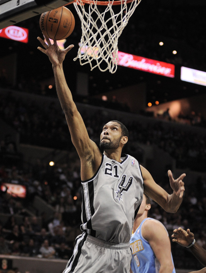 San Antonio Spurs' Tim Duncan goes for a layup during the first half of an NBA basketball game against the Denver Nuggets, Saturday, Nov. 17, 2012, in San Antonio. (AP Photo/Darren Abate)