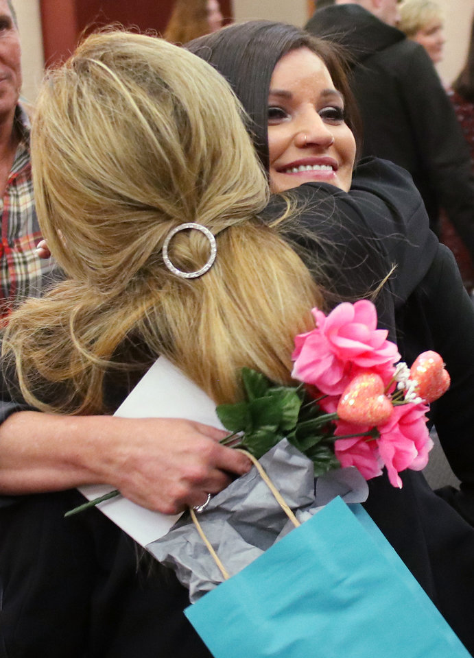 Photo - Brandi Davis gets a hug from her mother, Cara Goettsch, after the ceremony. Brandi Davis graduates from the ReMerge program in a ceremony at the Oklahoma History Center Thursday, February 28, 2019.  Photo by Doug Hoke/The Oklahoman