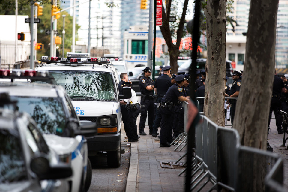 Photo - Officers keep watch in the park at Dag Hammarskjold Plaza near United Nations Headquarters Sunday, Sept. 18, 2016, in New York. Security is tightened after an improvised bomb was detonated in a dumpster Saturday night in the Chelsea section of the New York City. (AP Photo/Kevin Hagen)