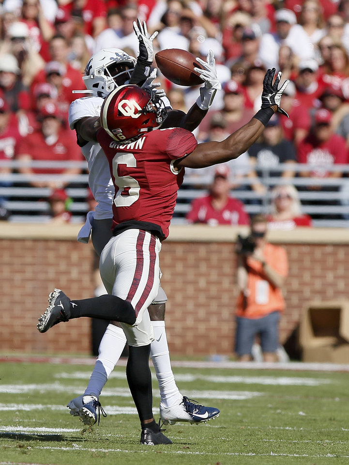 Photo - Oklahoma's Tre Brown (6) breaks up a pass intended for West Virginia's Trent Jackson (3) during a college football game between the University of Oklahoma Sooners (OU) and the West Virginia Mountaineers at Gaylord Family-Oklahoma Memorial Stadium in Norman, Okla, Saturday, Oct. 19, 2019. Oklahoma won 52-14. [Bryan Terry/The Oklahoman]