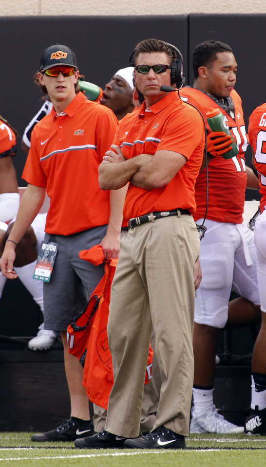 Photo - Oklahoma State head coach Mike Gundy watches from the sidelines during the college football game between the Oklahoma State Cowboys (OSU) and the Southeastern Louisiana Lions at Boone Pickens Stadium in Stillwater, Okla., Saturday, Sept. 12, 2015. Photo by Steve Sisney, The Oklahoman
