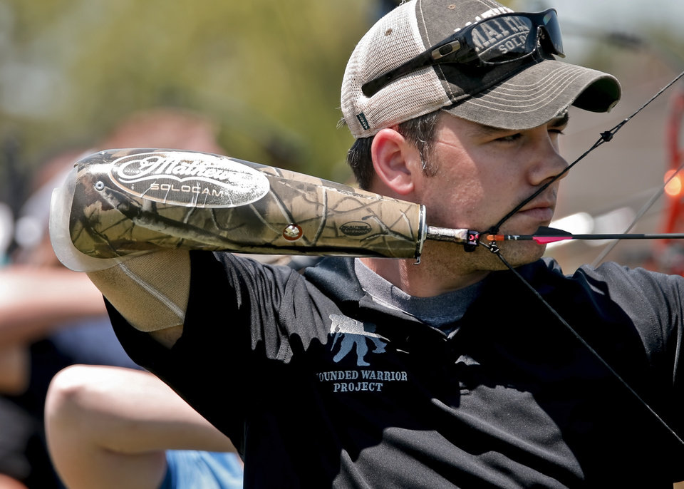 Lance Thornton lines up his shot while competing in the archery event during the Endeavor Games at the University of Central Oklahoma on Friday, June 7, 2013 in Edmond, Okla.  Photo by Chris Landsberger, The Oklahoman