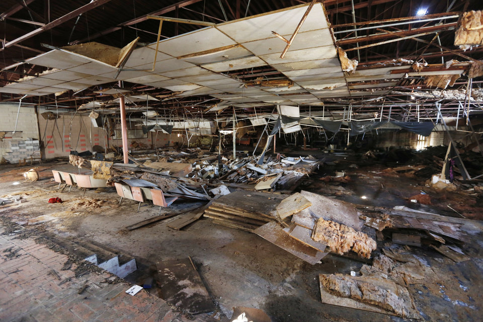 Photo -  Although some flooring remains, everything else of value has been stripped from the Bryant Center, one of numerous abandoned properties in northeast Oklahoma City.