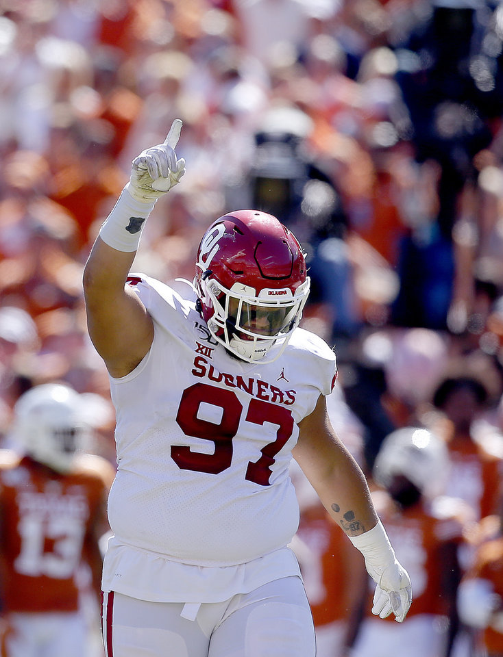 Record - Oklahoma's Marquise Overton (ninety seven) celebrates his sack on Texas quarterback Sam Ehlinger (eleven) within the fourth quarter at some point soon of the Crimson River Showdown college football sport between the University of Oklahoma Sooners (OU) and the Texas Longhorns (UT) at Cotton Bowl Stadium in Dallas, Saturday, Oct. 12, 2019. OU gained 34-27. [Sarah Phipps/The Oklahoman]