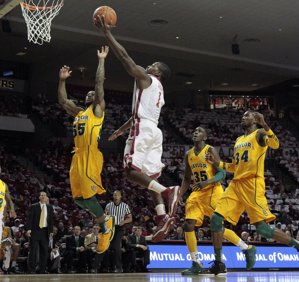 Oklahoma Sooner's Sam Grooms (1) drives to the basket as the University of Oklahoma Sooners (OU) men play the Baylor University Bears (BU) in NCAA, college basketball at The Lloyd Noble Center on Saturday, Feb. 23, 2013  in Norman, Okla. Photo by Steve Sisney, The Oklahoman