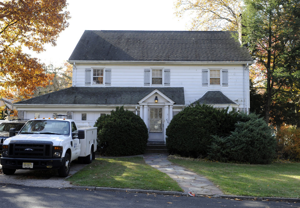 Photo - The house where Richard Shoop lived is seen in Teaneck, N.J. Tuesday, Nov. 5, 2013.  Shoop fired multiple shots inside New Jersey's largest shopping mall Monday, trapping hundreds of customers and employees for hours as police scoured stores for the shooter, who was found dead early Tuesday of a self-inflicted wound, authorities said. (AP Photo/Bill Kostroun)