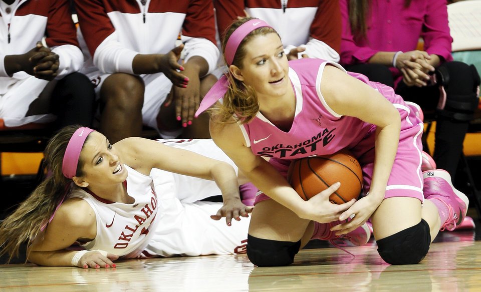 Photo - Oklahoma State's Liz Donohoe (4) grabs a loose ball in front of Oklahoma's Morgan Hook (10) in the first half during the women's Bedlam college basketball game between the OU Sooners and the OSU Cowgirls at Gallagher-Iba Arena in Stillwater, Okla., Sunday, Feb. 16, 2014. Photo by Nate Billings, The Oklahoman