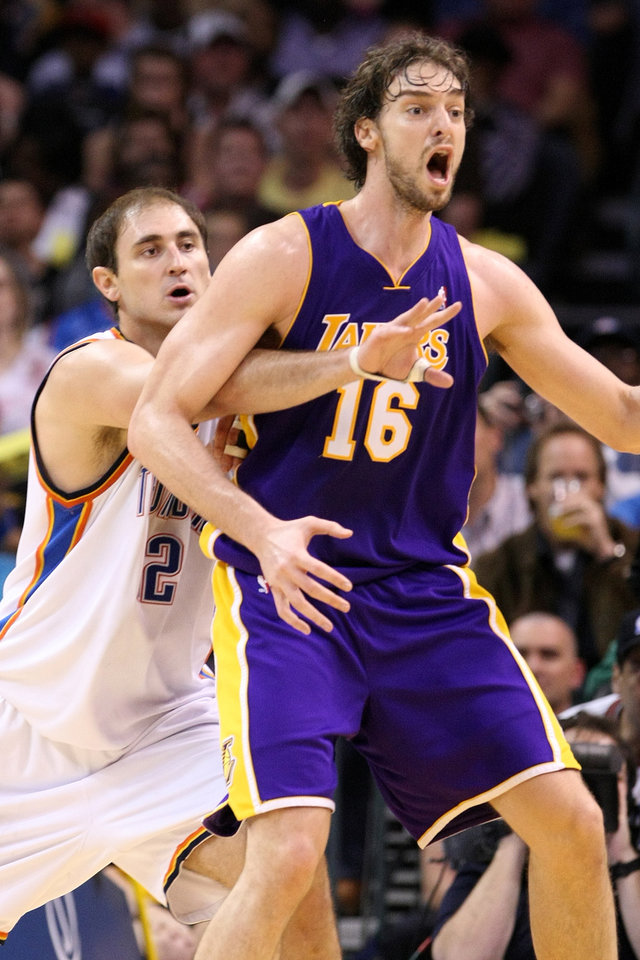 Photo - L.A. LAKERS / OKLAHOMA CITY THUNDER / LOS ANGELES LAKERS / NBA BASKETBALL  L.A. Lakers center Pau Gasol calls for the ball while being guarded by Thunder center Nenad Krstic  during the Thunder - Lakers game March 26, 2010 in the Ford Center in Oklahoma City.    BY HUGH SCOTT, THE OKLAHOMAN ORG XMIT: KOD