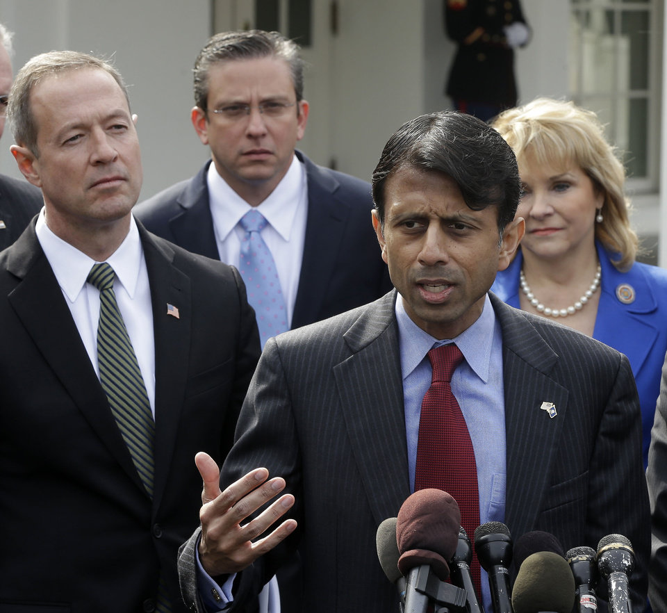 Photo - Louisiana Gov. Bobby Jindal answers questions during a news conference outside the White House in Washington, Monday, Feb. 25, 2013, following a meeting between National Governors Association (NGA) and President Barack Obama. From left are, Maryland Gov. Martin O'Malley, Puerto Rico Gov. Alejandro García Padilla, Jindal, and NGA Vice Chair, Oklahoma Gov. Mary Fallin. (AP Photo/Pablo Martinez Monsivais)