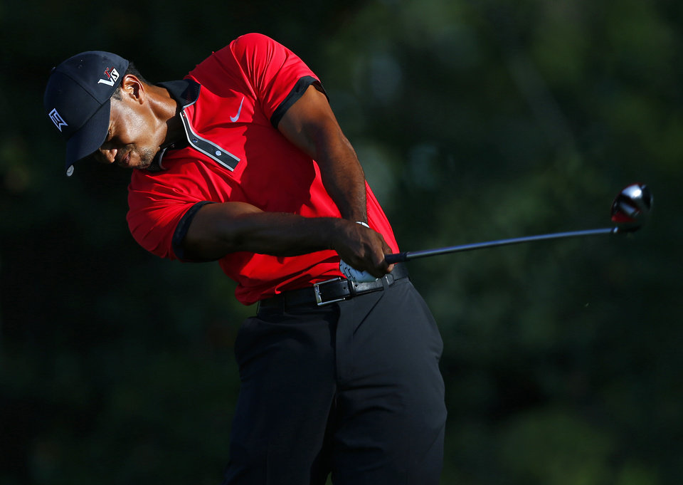 Photo - Tiger Woods tees off on the 16th hole during the final round of The Barclays golf tournament on Sunday, Aug. 25, 2013, in Jersey City, N.J. Woods finished in a four-way tie for second place. (AP Photo/Rich Schultz)