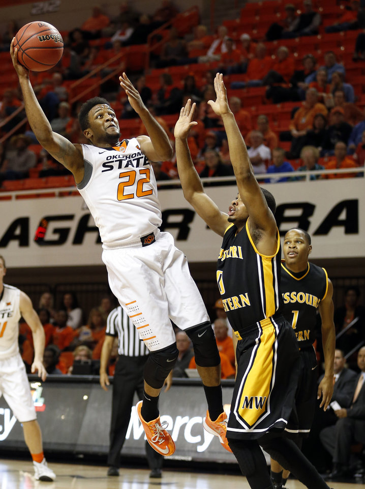 Photo - Oklahoma State's Jeff Newberry (22) shoots over Missouri Western Aaron Emmanuel during the men's college between Oklahoma State University and Missouri Western at Gallagher-Iba Arena in Stillwater, Okla., Saturday, Nov. 8, 2014.  Photo by Sarah Phipps, The Oklahoman