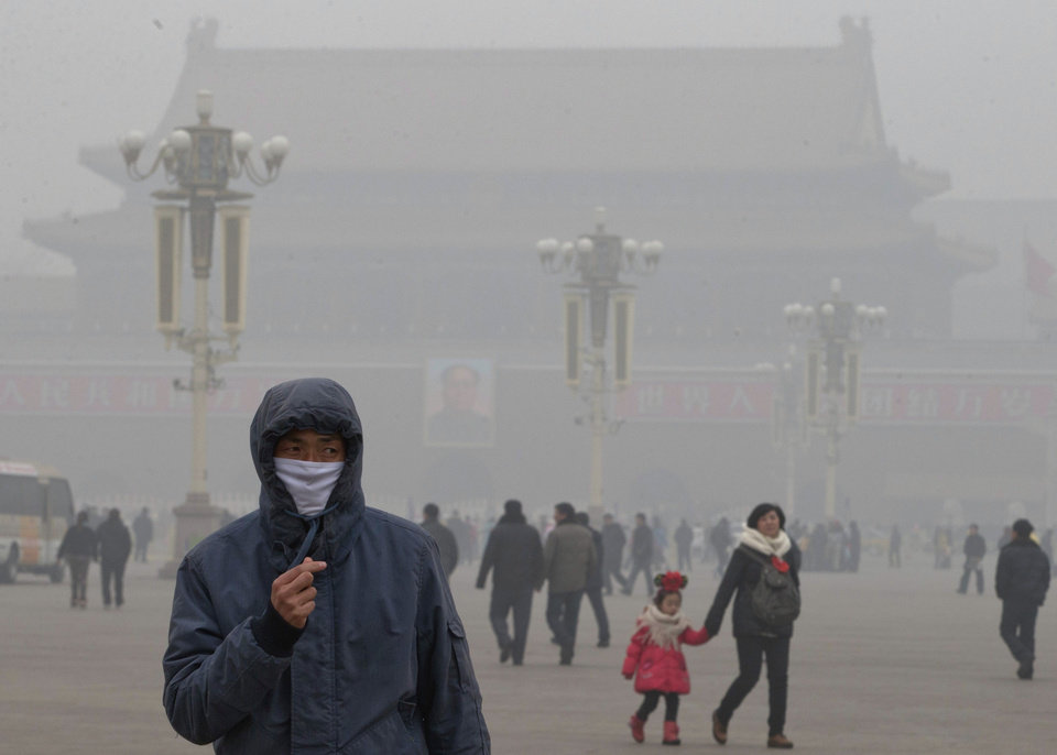 A man wears a mask on Tiananmen Square in thick haze in Beijing Tuesday, Jan. 29, 2013. Extremely high pollution levels shrouded eastern China for the second time in about two weeks Tuesday, forcing airlines in Beijing and elsewhere to cancel flights because of poor visibility and prompting government warnings for residents to stay indoors. (AP Photo/Ng Han Guan)