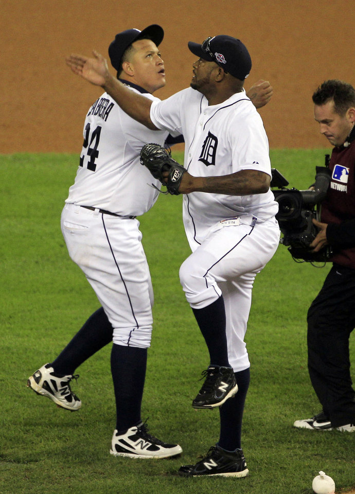 Photo -   Detroit Tigers relief pitcher Jose Valverde, right, and teammate Miguel Cabrera celebrate after the last out in the ninth inning of Game 1 of the American League division baseball series against the Oakland Athletics, Saturday, Oct. 6, 2012, in Detroit. The Tigers won 3-1. (AP Photo/Carlos Osorio)
