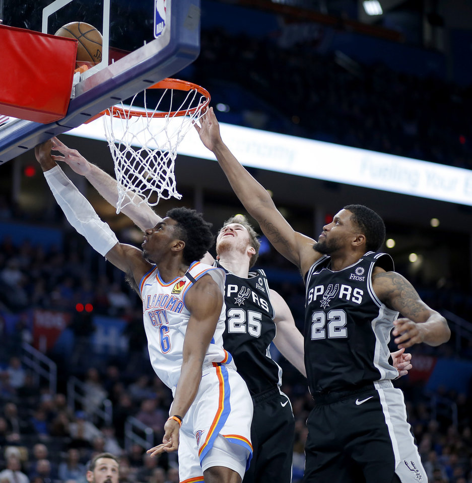 Photo - Oklahoma City's Hamidou Diallo (6) puts up a shot beside San Antonio's Jakob Poeltl (25) and Rudy Gay (22) during an NBA basketball game between the Oklahoma City Thunder and the San Antonio Spurs at Chesapeake Energy Arena in Oklahoma City, Tuesday, Feb. 11, 2020. San Antonio won 114-106. [Bryan Terry/The Oklahoman]