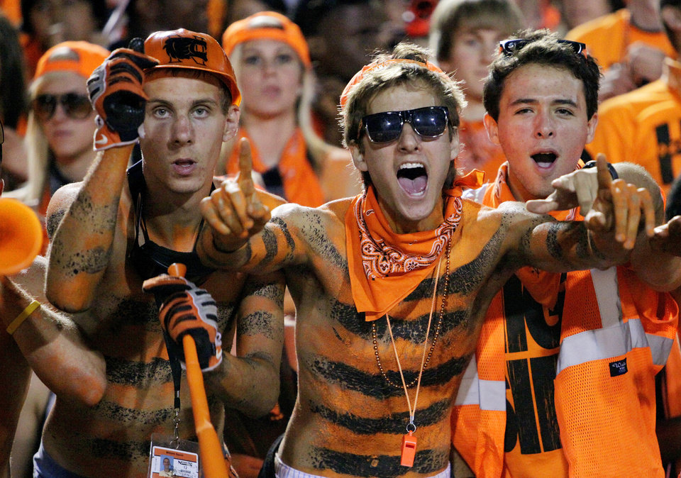 Photo - Will Saton (left) and Garrett Voss (glasses) shout as their Norman High Tigers play Norman North at Harve Collins Field on Friday Sept. 3, 2010, in Norman, Okla.  Photo by Steve Sisney, The Oklahoman