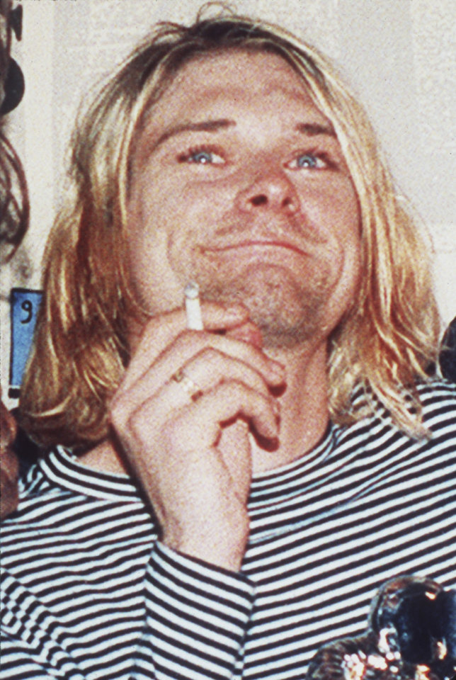 Photo - FILE - In this 1993 file photo, lead singer of Nirvana Kurt Cobain is photographed. It's been two decades since the Nirvana frontman took his own life yet he remains on in the thoughts of those he influenced and entertained. He's a touchstone for young musicians clutching guitars the world over and his story is a tale of both inspiration and caution. His influence still ripples across the surface of pop music and his shadow even looms in the hip-hop world where he's been a referenced by Jay Z, Kanye, Kendrick Lamar, Drake and Jay Electronica in various ways recently.  (AP Photo/Mark J.Terrill, file)