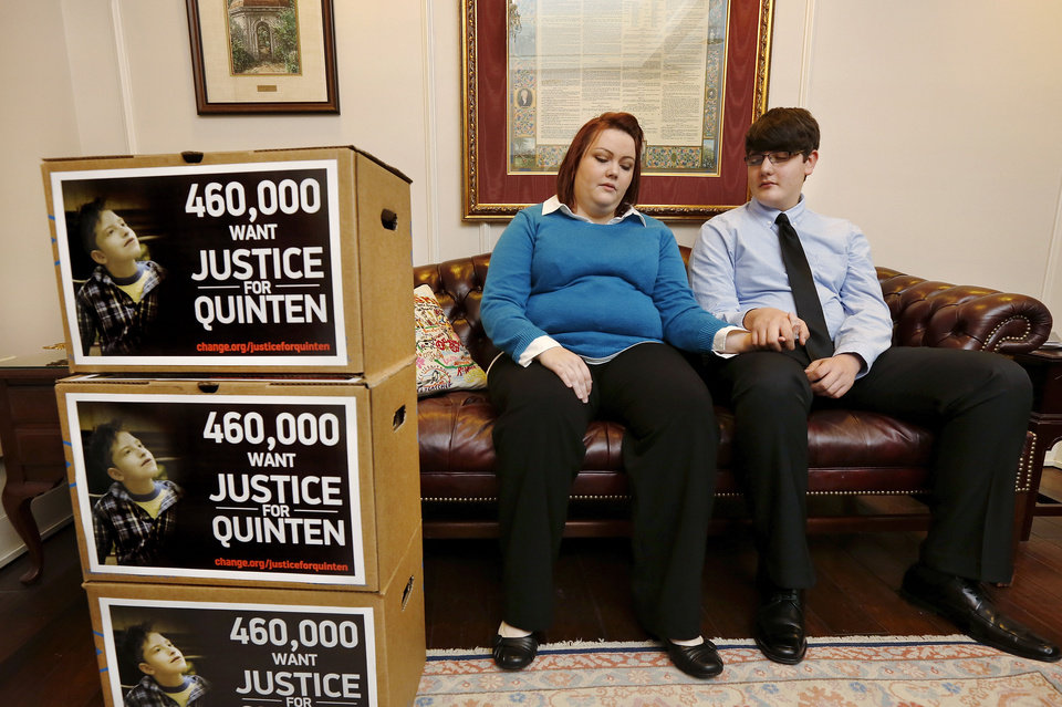 Photo - Valerie Wood-Harber and her brother, Cameron Wood, console each other in the office of Gov. Mary Fallin after delivering several boxes containing petitions signed by 460,000  Oklahomans to the governor Tuesday, Jan. 7, 2014. They are requesting an investigation of Oklahoma child welfare services. Their younger brother, Quinten, a special needs child, died a year ago and is the main reason they circulated the petitions and requested the investigation.  Photo by Jim Beckel, The Oklahoman  Jim Beckel - THE OKLAHOMAN