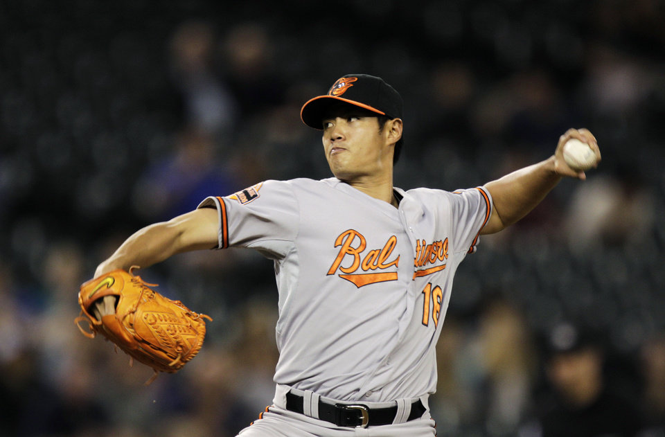 Photo -   Baltimore Orioles starting pitcher Wei-Yin Chen, of Taiwan, throws against the Seattle Mariners in the third inning of a baseball game, Tuesday, Sept. 18, 2012, in Seattle. (AP Photo/Ted S. Warren)