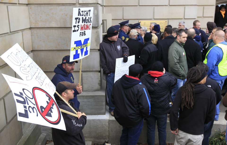 State police keep union workers from entering the Capitol in Lansing, Mich., Thursday, Dec. 6, 2012 as Senate Republicans introduced right-to-work legislation in the waning days of the legislative session. The outnumbered Democrats pledged to resist the proposal and said rushing it through the legislative system would poison the state\'s political atmosphere. (AP Photo/Carlos Osorio)