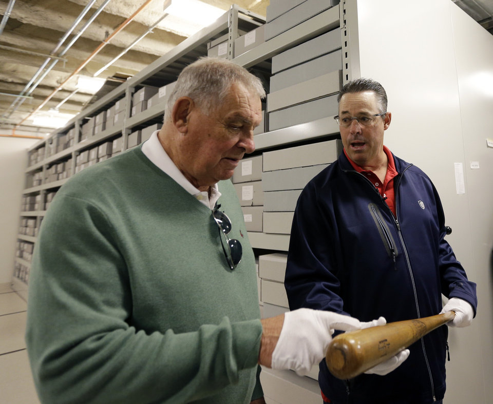 Photo - Former Atlanta Braves manager Bobby Cox, left, and former pitcher Greg Maddux hold a Lou Gehrig bat during their orientation visit at the Baseball Hall of Fame on Monday, March 24, 2014, in Cooperstown, N.Y. They will be inducted to the hall in July. (AP Photo/Mike Groll)