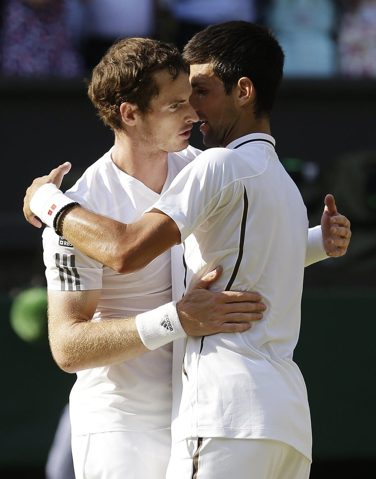 Photo - Andy Murray of Britain, left, embraces Novak Djokovic of Serbia after winning the Men's singles final match at the All England Lawn Tennis Championships in Wimbledon, London, Sunday, July 7, 2013. (AP Photo/Anja Niedringhaus, Pool)