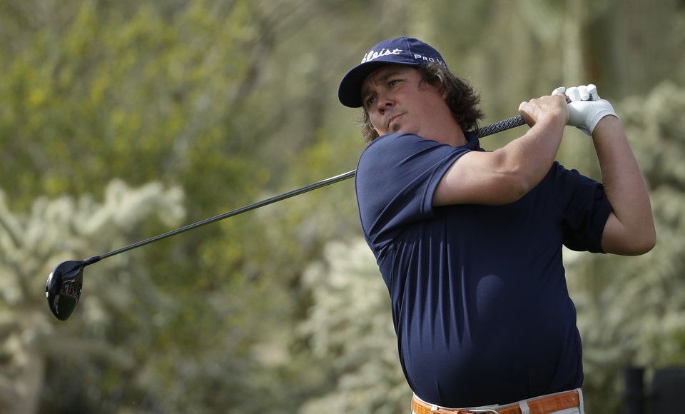 Photo - Jason Dufner watches his tee shot on the 17th hole during his match against Scott Stallings during the first round of the Match Play Championship golf tournament on Wednesday, Feb. 19, 2014, in Marana, Ariz. (AP Photo/Ted S. Warren)