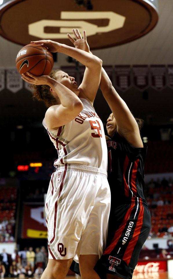 Oklahoma Sooner\'s Joanna McFarland (53) shoots guarded by Tech\'s Kelsi Baker (41) as the University of Oklahoma Sooners (OU) play the Texas Tech Lady Red Raiders in NCAA, women\'s college basketball at The Lloyd Noble Center on Saturday, Jan. 12, 2013 in Norman, Okla. Photo by Steve Sisney, The Oklahoman