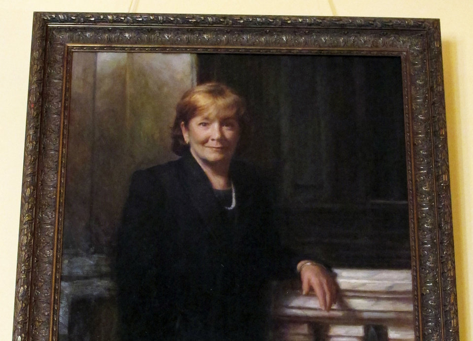In this Jan. 3, 2013 photo, the portrait of former Gov. Nancy Hollister, who served in that role for only 11 days, hangs in The Ladies' Gallery at the Statehouse in Columbus, Ohio. Artists often put oil to canvas at this time of year to render official portraits of a governor or legislative leader who's coming or going from office. (AP Photo/Kantele Franko)