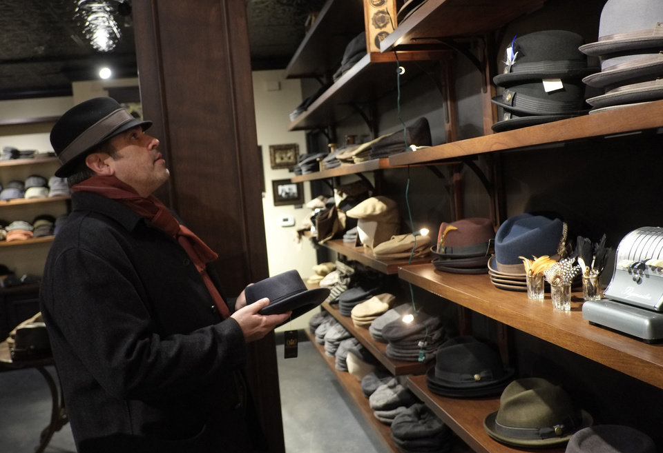 Charles Godyear looks over the new hats at Goorins Hat Store in Uptown, Minneapolis, December 20, 2012. The new old-school men's hat shop has opened in Uptown Minneapolis, just as the trend has hit its stride. The heritage menswear movement has pushed hats back on to guys' heads. Baseball caps have given way to Fedoras, Gatsbys and Bowlers. (Tom Wallace/Minneapolis Star Tribune/MCT)