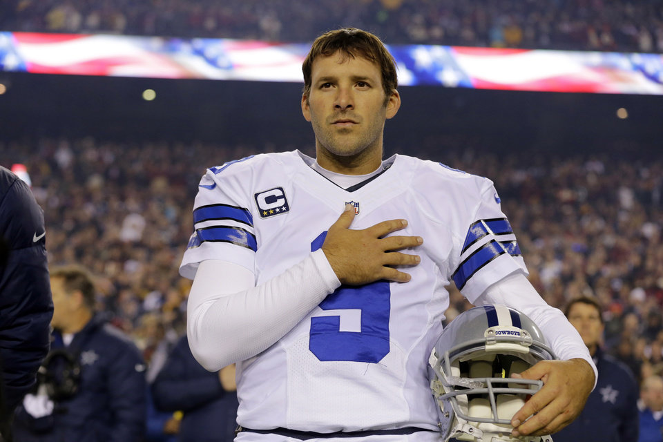 File- This Dec. 30, 2012 file photo shows Dallas Cowboys quarterback Tony Romo (9) standing during the national anthem before an NFL football game against the Washington Redskins in Landover, Md.  Romo and the Cowboys have agreed on a six-year contract extension worth $108 million, with about half of that guaranteed.  The agreement was reported on the team's website Friday March 29, 2013.  (AP Photo/Alex Brandon, File)