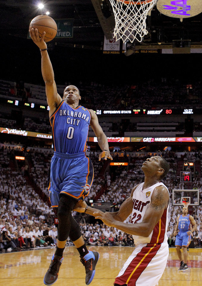 Photo - Oklahoma City's Russell Westbrook (0) goes past Miami's James Jones (22) during Game 4 of the NBA Finals between the Oklahoma City Thunder and the Miami Heat at American Airlines Arena, Tuesday, June 19, 2012. Oklahoma City lost 104-98.  Photo by Bryan Terry, The Oklahoman