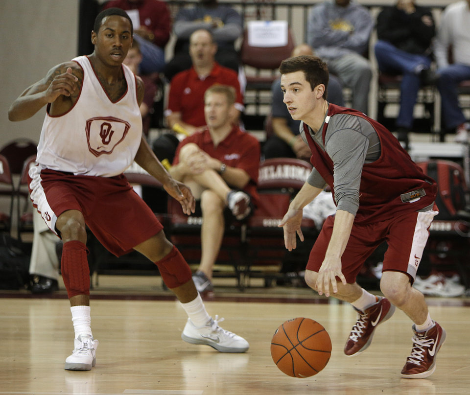 James Fraschilla (13) runs past Je'lon Hornbeak (5) during a Oklahoma University scrimmage basketball game at McCasland Field House in Norman, Okla., Saturday, Oct. 20, 2012.  Photo by Garett Fisbeck, The Oklahoman