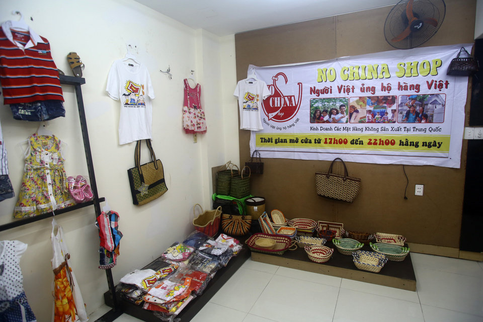 """Photo - This March 14, 2013 photo shows a corner inside the """"No China Shop"""", which sells only goods made in Vietnam - children's clothes, shoes and vegetables- and offers to source others in Ho Chi Minh City. The shop was opened in Dec. 2013 by Paulo Thanh Nguyen in Ho Chi Minh city, Vietnam. His decision to launch the business was as much about harnessing and spreading anger against China as it was about making money. (AP Photo/Na Son Nguyen)"""