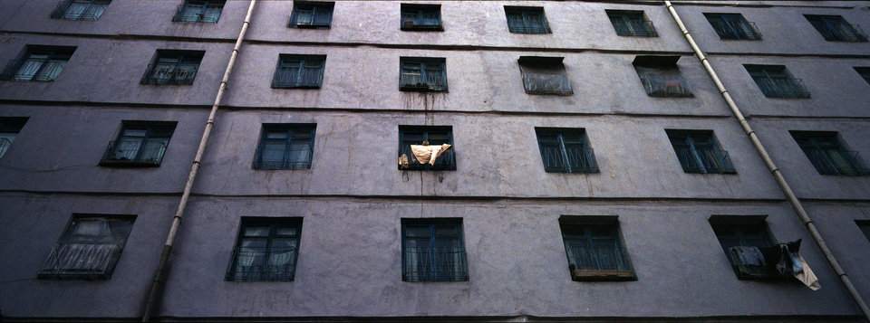 Photo - In this Feb. 18, 2012 photo, a coat dries on the balcony of an apartment block in central Pyongyang. (AP Photo/David Guttenfelder)