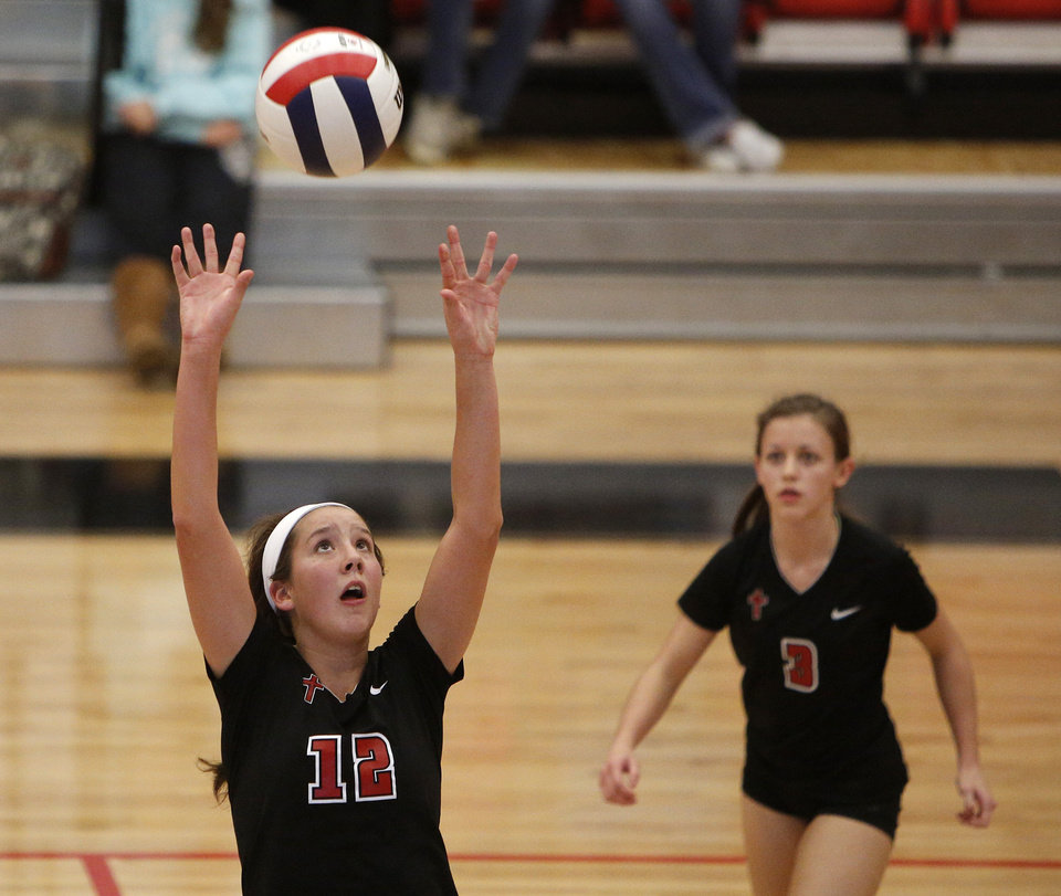 Bishop Kelley's Claire Kelley (12) sets the ball during the OSSAA 6A State Volleyball Championship between Bishop Kelley and Edmond Memorial at Westmoore High School in Moore, Okla., Saturday, Oct. 13, 2012.  Photo by Garett Fisbeck, The Oklahoman