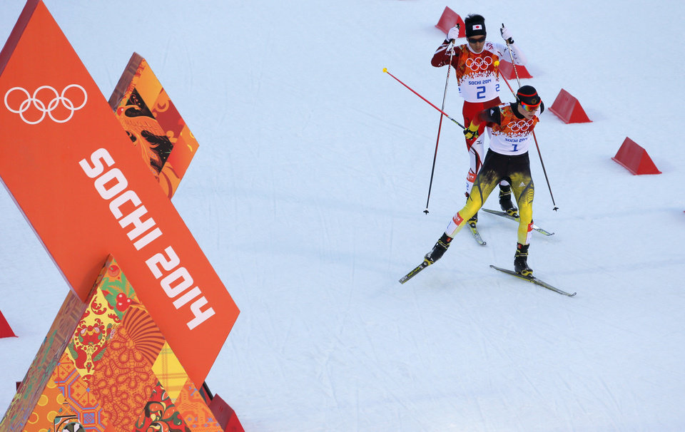 Photo - Germany's gold medal winner Eric Frenzel, right, and Japan's silver medal winner Akito Watabe ski during the cross-country portion of the Nordic combined at the 2014 Winter Olympics, Wednesday, Feb. 12, 2014, in Krasnaya Polyana, Russia. (AP Photo/Dmitry Lovetsky)