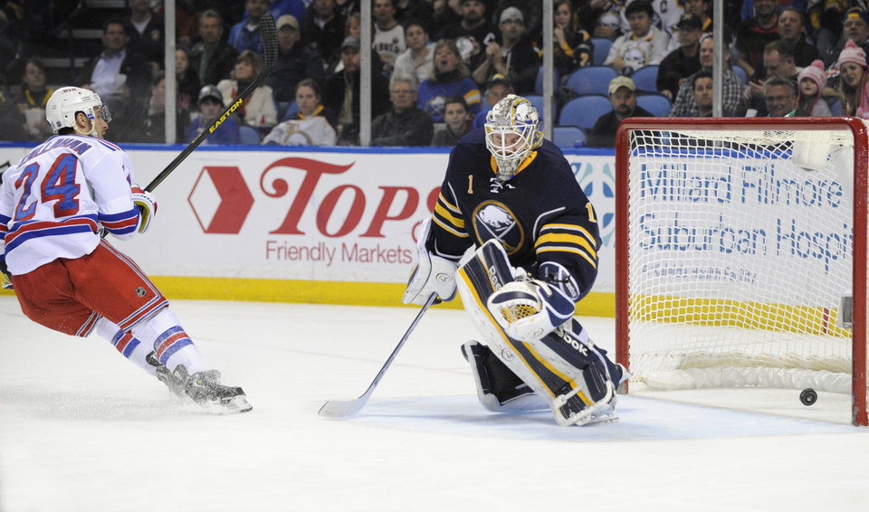Photo - New York Rangers right winger Ryan Callahan (24) reacts after he scores on Buffalo Sabres goaltender Jhonas Enroth (1) during the second period of an NHL hockey game in Buffalo, N.Y., Friday, April 19, 2013. (AP Photo/Gary Wiepert)
