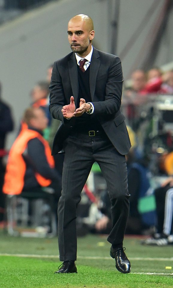 Photo - Bayern head coach Pep Guardiola of Spain applauds during the Champions League quarterfinal second leg soccer match between Bayern Munich and Manchester United in the Allianz Arena in Munich, Germany, Wednesday, April 9, 2014. Munich defeated Manchester by 3:1. (AP Photo/Kerstin Joensson)
