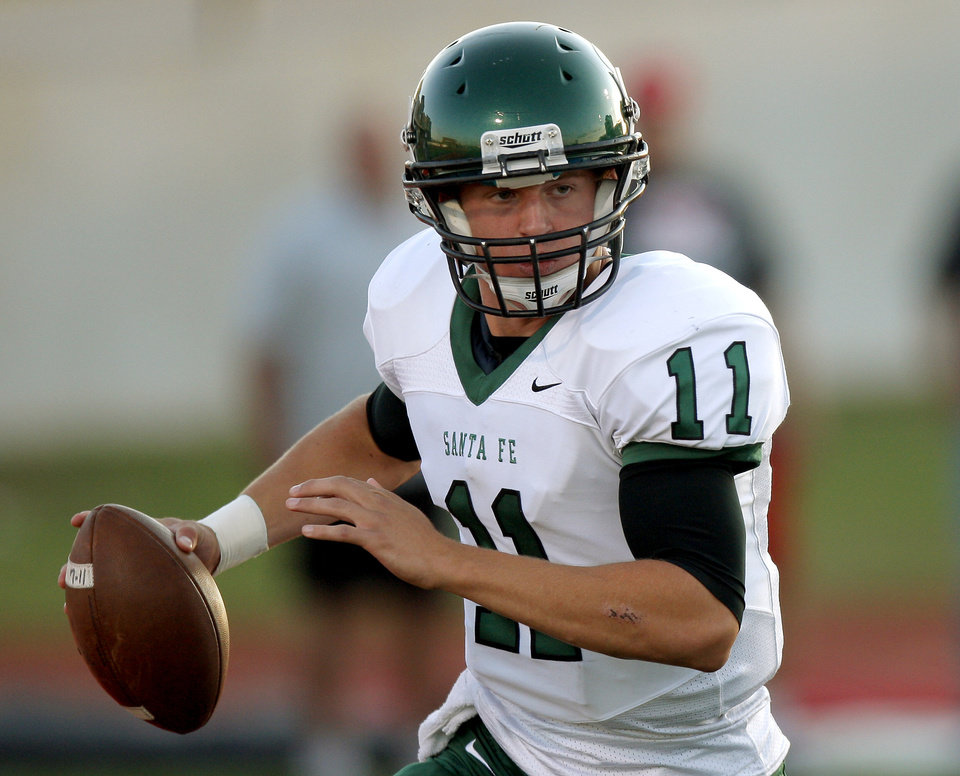 Photo - Edmond Santa Fe's Justice Hansen rolls out against Yukon during a high school football game in Yukon, Okla., Friday, Sept. 9, 2011. Photo by Bryan Terry, The Oklahoman