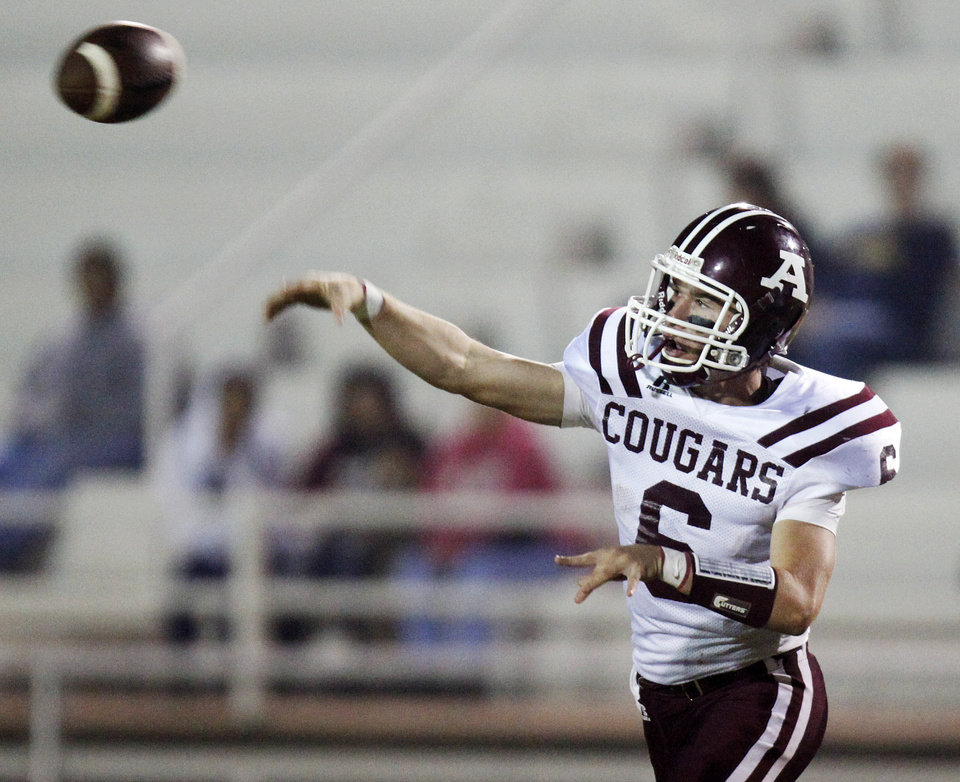 Photo - Wyatt Robson (6) passes for Ada during a high school football game between Ada and U.S. Grant at C.B. Speegle Stadium in Oklahoma City, Friday, Sept. 16, 2011. Photo by Nate Billings, The Oklahoman