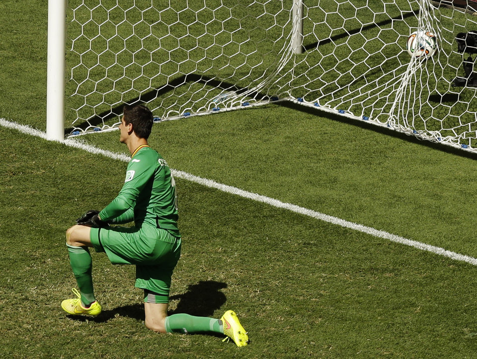 Photo - Belgium's goalkeeper Thibaut Courtois is on his knee as Argentina's Gonzalo Higuain kick goes in for a goal during the World Cup quarterfinal soccer match between Argentina and Belgium at the Estadio Nacional in Brasilia, Brazil, Saturday, July 5, 2014. (AP Photo/Thanassis Stavrakis)