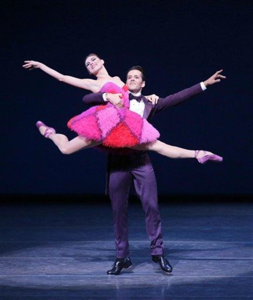 Photo - This Thursday, Sept. 20, 2012 image released by the New York City Ballet shows Tiler Peck, left, and Robert Fairchild performing in