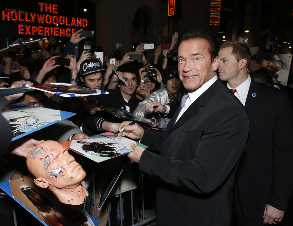 Photo - FILE - In this Jan. 14, 2013 file photo, Arnold Schwarzenegger attends the LA premiere of