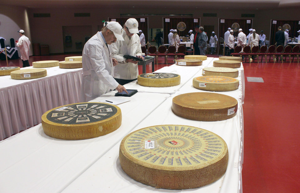 Photo - Judges enter their findings into iPads during the first day of the 2014 World Championship Cheese Contest, Tuesday, March 18, 2014, in Madison, Wis. Entries in the 2014 World Championship Cheese Contest reached a new record this year, growing five percent to more than 2,600 entries from 22 nations around the world.  (AP Photo/Carrie Antlfinger)