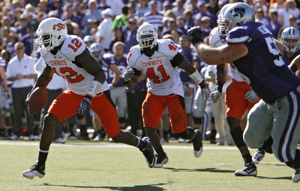 Photo - Oklahoma State's Johnny Thomas (12) returns an interception for a touchdown during the second half of the college football game between the Oklahoma State University Cowboys (OSU) and the Kansas State University Wildcats (KSU) on Saturday, Oct. 30, 2010, in Manhattan, Kan.   Photo by Chris Landsberger, The Oklahoman