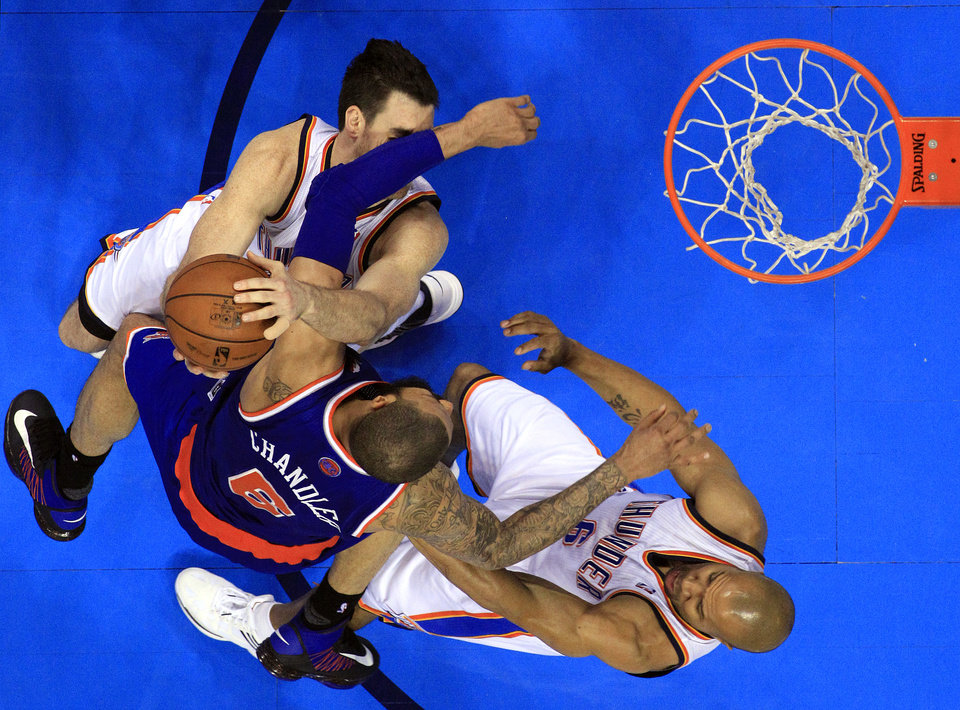 Photo - New YorK's Tyson Chandler (6) collides with Oklahoma City's Nick Collison (4) and Derek Fisher (6) during NBA basketball game between the Oklahoma City Thunder and the New York Knicks at the Chesapeake Energy Arena, Sunday, April 7, 2010, in Oklahoma City. Chandler was called for a technical foul. Photo by Sarah Phipps, The Oklahoman
