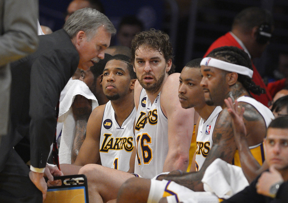 Photo - Los Angeles Lakers head coach Mike D'Antoni, left, talks to Darius Morris, second from left, Pau Gasol, third from left, of Spain, Andrew Goudelock, second from right, and Jordan Hill during the second half in Game 4 of a first-round NBA basketball playoff series against the San Antonio Spurs, Sunday, April 28, 2013, in Los Angeles. The Spurs won 103-82. (AP Photo/Mark J. Terrill)